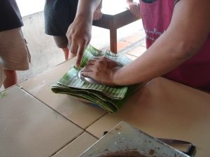 Chef Heng, cutting disks of banana leaf