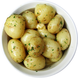 A bowl of Jersey Royal potatoes with butter and a little parsley.