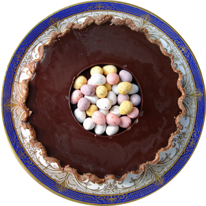 A rich chocolate and bourbon tart, topped with mini Easter eggs