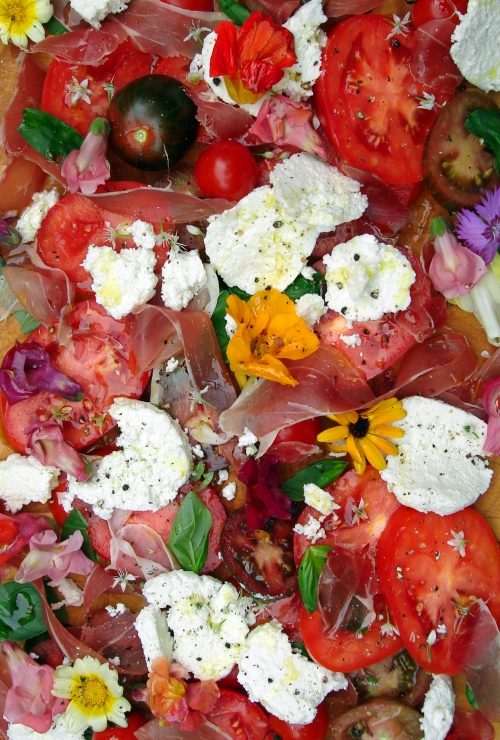 Homemade Mozzarella with heritage tomatoes, edible flowers and Parma ham