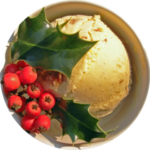Christmas Pudding Ice-Cream decorated with holly leaves and berries