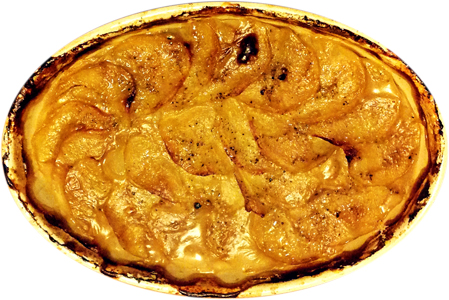 A dish of potatoes gratin. Neither a dauphinoise nor a boulangere, but something in between.